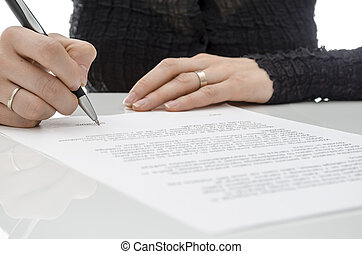 Business woman signing a contract above signature line -...