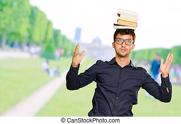 Young Man Balancing Book On Head - Young Man Balancing Books...