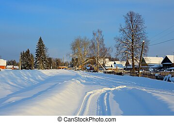 snow-covered village with a triangular roof on the road