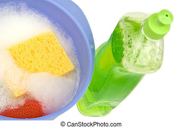 Dishwashing - Different cleaning tools on a white background