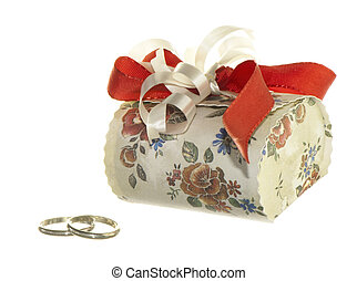 Wedding favors - wedding favors and wedding rings on white...