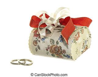 Wedding favors - wedding favors and wedding rings on white...