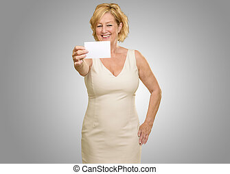 Mature Woman Holding Visiting Card On Grey Background