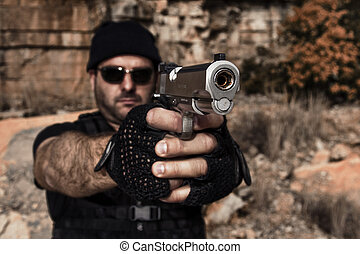 man pointing a gun to the camera - View of a man with dark...