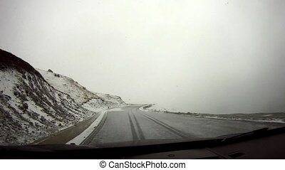 Snowy mountain road - Driving along a snowy mountain road,...