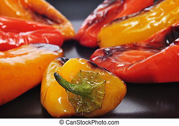 roasted sweet bite peppers of different colors - closeup of...