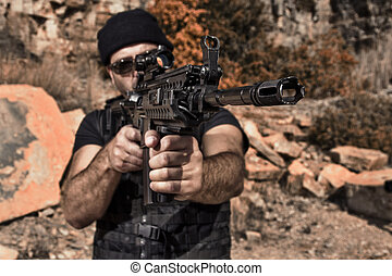 man pointing with a machine gun