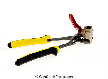 forceps - yellow pliers and an old valve on a white...