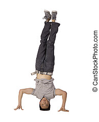 head stand dance move - Teenage male dancer doing a head...