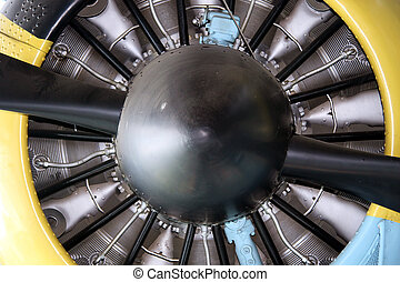 Propeller and radial engine of an airplane close up
