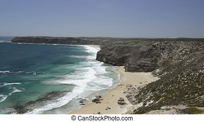 Australian Coastline - Ocean waves crashing on a sandy beach...
