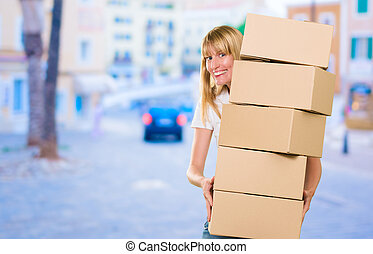 woman holding a pile of boxes