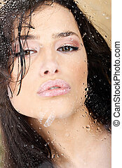 woman with sensual lips behind glass - Pretty woman with...