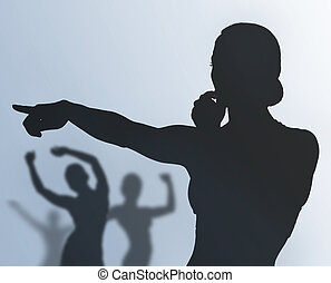 fitness instructor and training people - silhouette of...