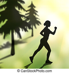 silhouette of jogging woman in forest