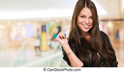 young happy woman posing at the mall