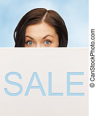 lovely woman with sale billboard - picture of lovely woman...