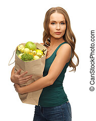 woman with shopping bag full of fruits - picture of woman...