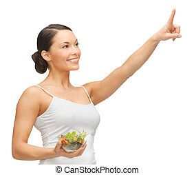 woman with salad - woman holding salad and working with...