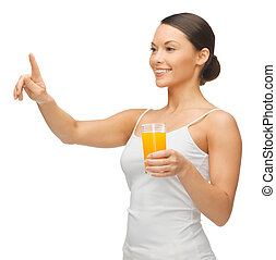 woman with glass of juice - woman holding glass of juice and...
