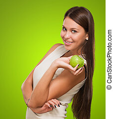 Portrait Of A Young Woman Holding Green Apple