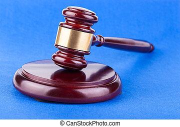 judges gavel on blue background - Wooden brown judges gavel...