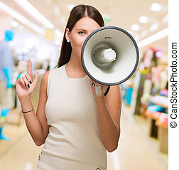 Young Woman Holding Megaphone at a mall