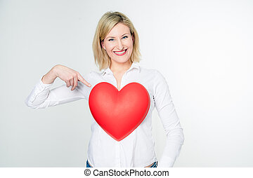 Woman pointing to her Heart