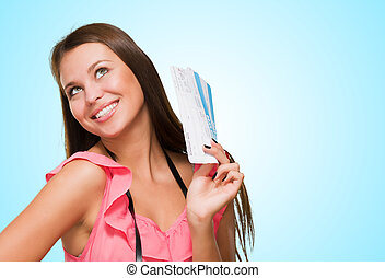 Young Woman With Boarding Pass And Camera against a blue...