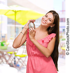 Beautiful Woman Holding Shaker at a restaurant