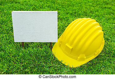 White wood sign and Safety helmet - Empty White wood sign...