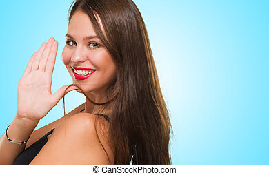 Young Woman With Stop Gesture Sign against a blue background
