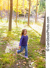 Autumn kid girl running poplar tree forest motion blur in...