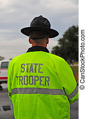 State trooper wearing yellow rain jacket