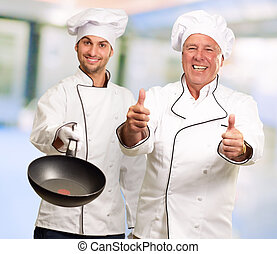 Portrait Of Two Happy Male Chef, Indoors
