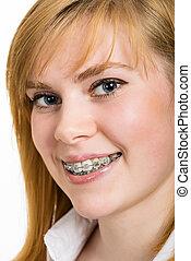 bonito, jovem, mulher, suportes, dentes