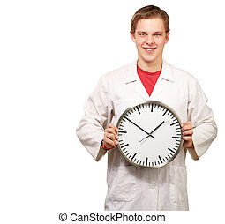 Portrait of a doctor holding a clock on white background