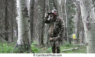 Bowhunter - a bowhunter prepares to shoot with a recurve bow...