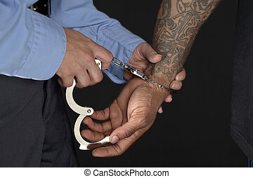 560 police officer handcuffing a man - Closeup shot of a...