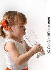 Pint girl - The small girl is drincking water from glas...