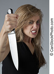 abused woman with knife - Portrait image of an abused woman...