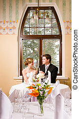 Bride and groom toasting - Happy couple doing a toast in the...