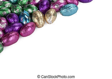chocolate eggs in white background - Cropped image of a...