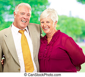 Portrait Of Happy Mature Couple, Outdoors