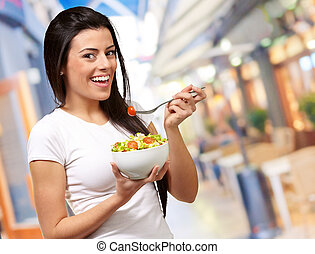 Young Girl Eating Salad From Bowl, Indoor