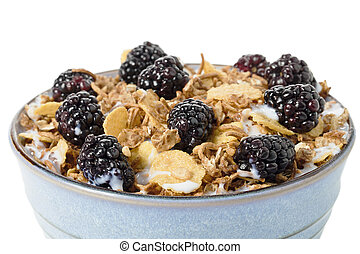 cropped image of blackberry fruits and cereal - Close-up...