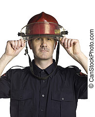 fireman with head gear - Close-up image of a fireman with...