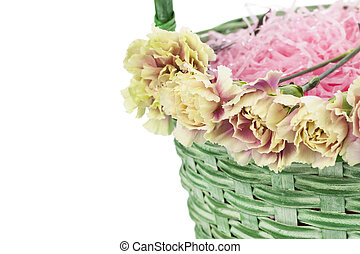flowers in basket with pink shredded papers