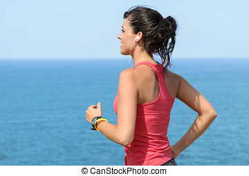 Woman exercising on summer at seaside - Woman running with...