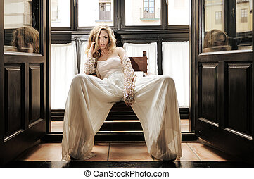 Sexy blonde woman in window - Portrait of a sexy blonde...
